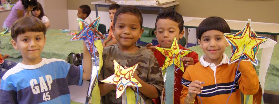 school age Somerville MA children displaying artwork