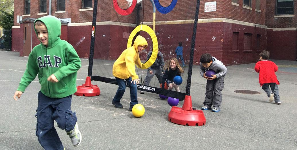 group of Somerville children playing a ball game outside